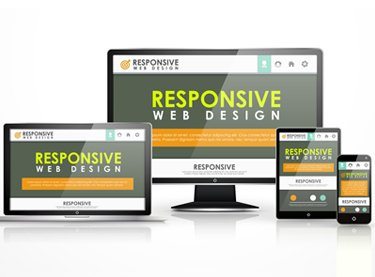 "Sets of monitors and mobile devices on a website in development by a web design company that reads ""Responsive Web Design"""