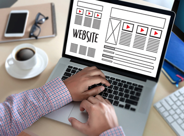 A web designer working on a website design Tampa FL businesses want to help drive leads and meet internet marketing strategy goals