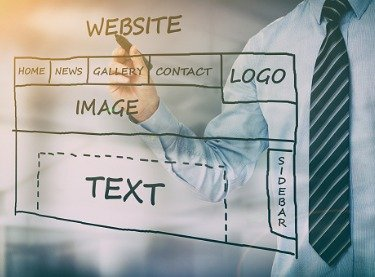 Concept of a man performing Business Website Development in Tampa FL by writing a website design on glass