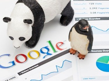 Plastic toys of a panda and penguin representing designated changes in Google's algorithm named according to the animals