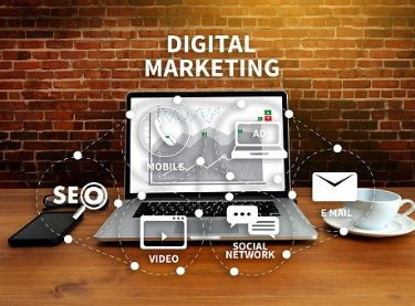 Concept of Digital Marketing in Tampa FL with a laptop surrounded by images and online marketing terms