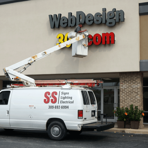 S & S Signs  fixing WebDesign309's Sign
