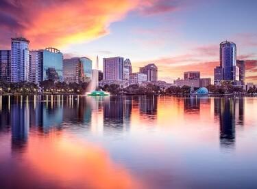 The Orlando FL city skyline at sunset